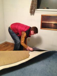 Matt revealing the beautiful hardwood floors